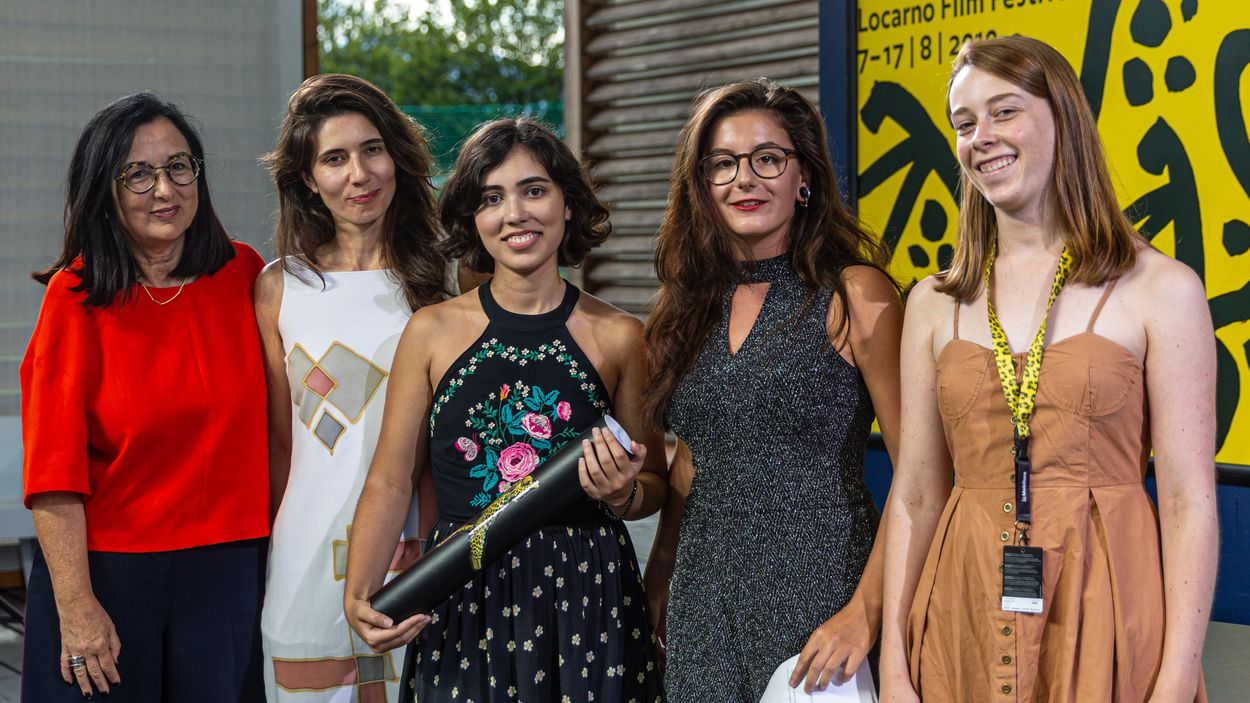 Camila Kater with her producers Chelo Loureiro and Lívia Perez, and two representatives of the Youth Jury, Locarno 2019